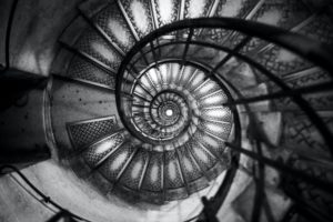Spiral staircase leading up the interior of the Arc De Triomphe