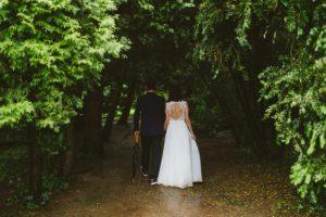 Wedding walk dark forest path